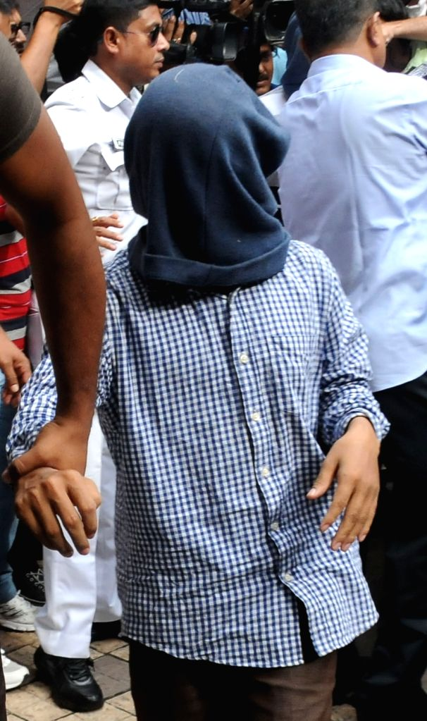 One of the six suspected Jamaat-ul-Mujahideen Bangladesh (JMB) activists who were arrested from Assam and West Bengal being taken to be produced at a Kolkata court on Sept 26, 2016. ...