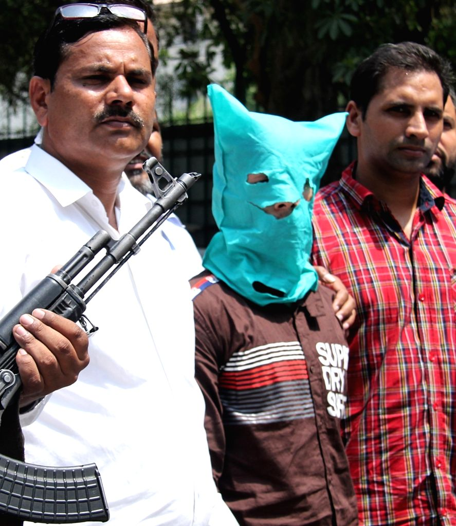 One of the two persons, arrested by the Delhi Police following a gunfight in New Delhi, on June 7, 2019. The encounter took place in New Seelampur area, when the two arrested, identified ...
