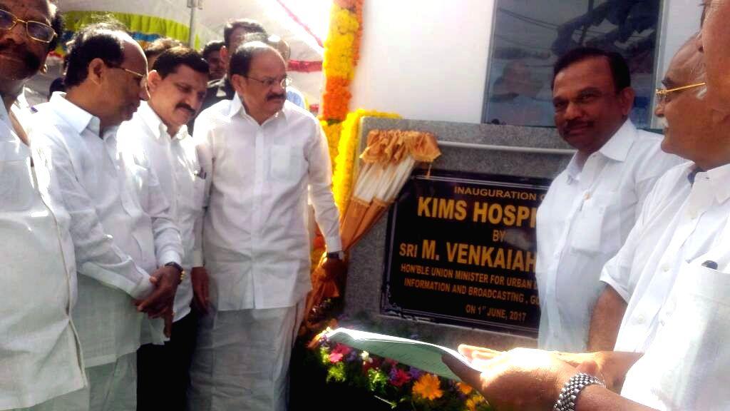 Ongole (Andhra Pradesh): Union Minister for Urban Development, Housing & Urban Poverty Alleviation and Information & Broadcasting M. Venkaiah Naidu unveils the plaque to inaugurate the KIMS ... - M. Venkaiah Naidu
