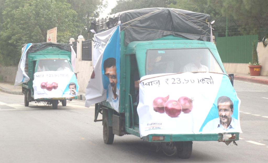 Onion mobile vans flagged off by Delhi Chief Minister Arvind Kejriwal to provide onions at Rs 23.90 per kg in all 70 Vidhan sabhas, in New Delhi on Sep 28, 2019. The Delhi government had ... - Arvind Kejriwal