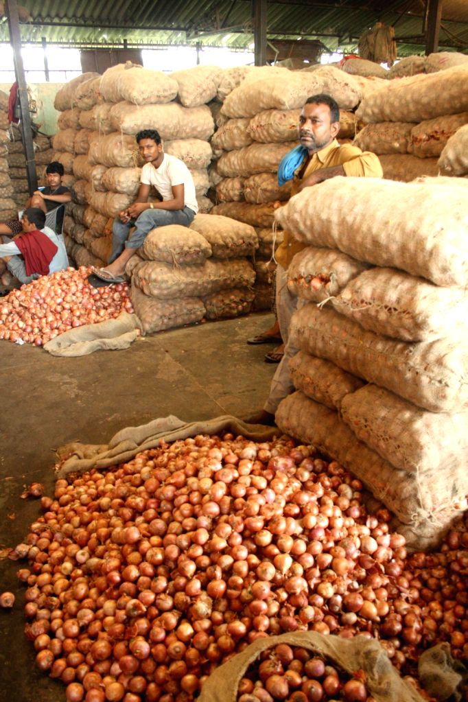 Onion wholesale market at  Azadpur in Delhi on August 17,2013. (Amlan Paliwal/IANS)