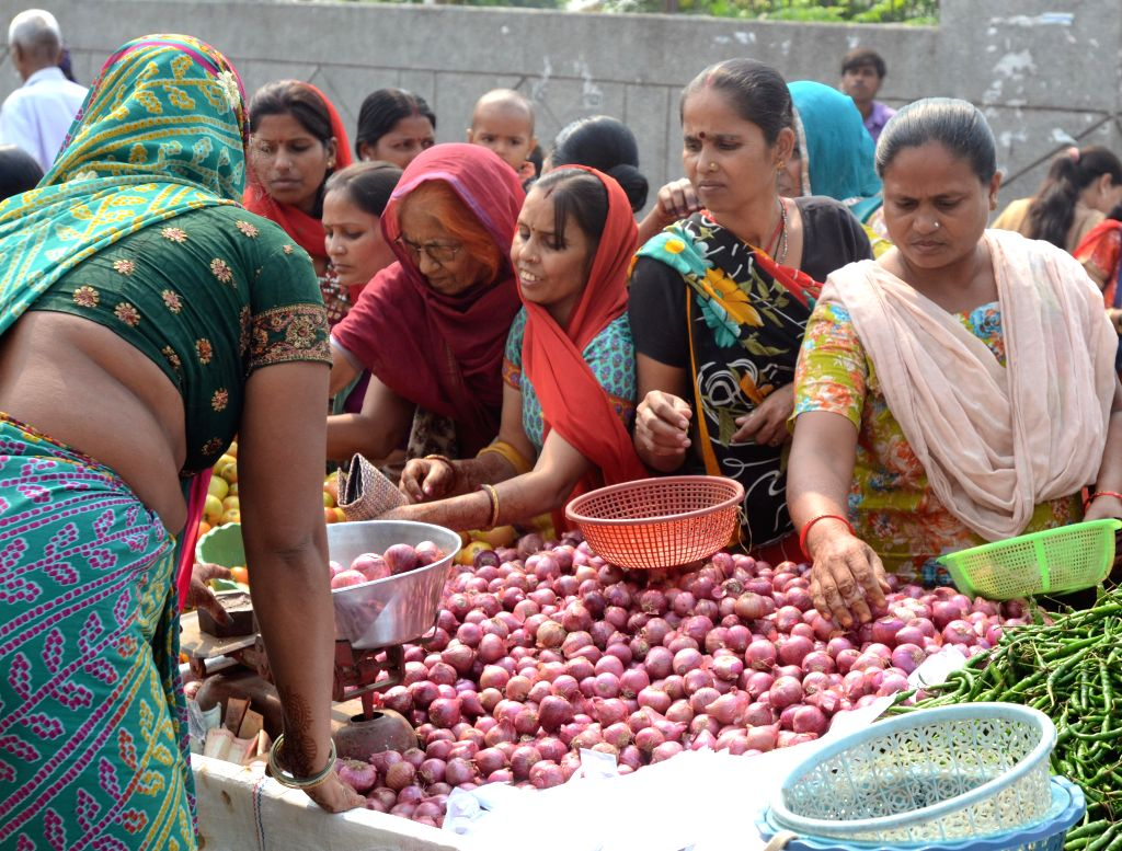 : Onions being sold at a market in New Delhi on Oct. 23, 2013. Onion prices has reached Rs. 100 per kg in some parts of Delhi. (Photo: IANS).