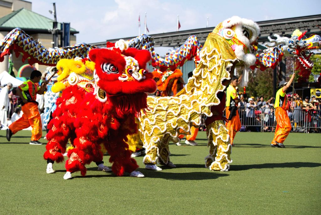 ONTARIO (CANADA), Sept. 21, 2019 Actors perform lion and dragon dance during the 2019 Dragon Lion Dance Festival in Mississauga of Ontario, Canada, Sept. 21, 2019. More than 20 lion dance ...