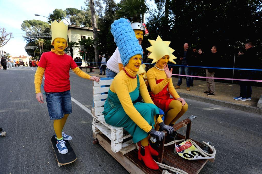 "OPATIJA (CROATIA), Feb. 24, 2019 People participate in ""Balinjerada"" race during a carnival parade in Opatija, Croatia, on Feb. 24, 2019."