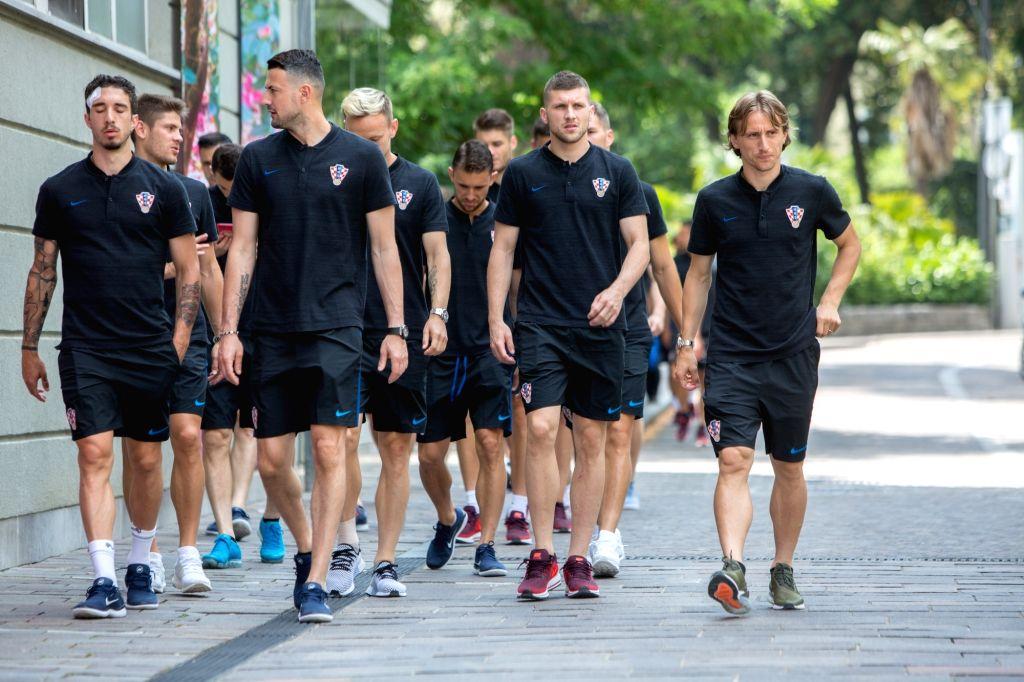 OPATIJA, June 5, 2018 - Players of Croatian national football team Danijel Subasic (front L2), Ante Rebic (R2) and Luka Modric (R) walk on the street of Opatija, Croatia, on June 4, 2018. The team is ...
