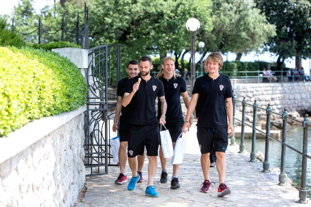 OPATIJA, June 5, 2018 - Players of Croatian national football team Mateo Kovacic (L1), Marcelo Brozovic (L2), Domagoj Vida (L3) and Tin Jedvaj (R) walk on the street of Opatija, Croatia, on June 4, ...