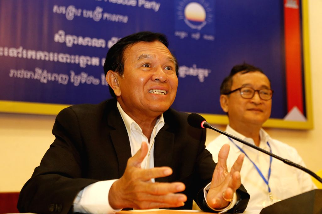 Opposition Cambodia National Rescue Party (CNRP) vice president Kem Sokha (L) speaks during a party conference in Phnom Penh, Cambodia, Oct. 2, 2015. The ...