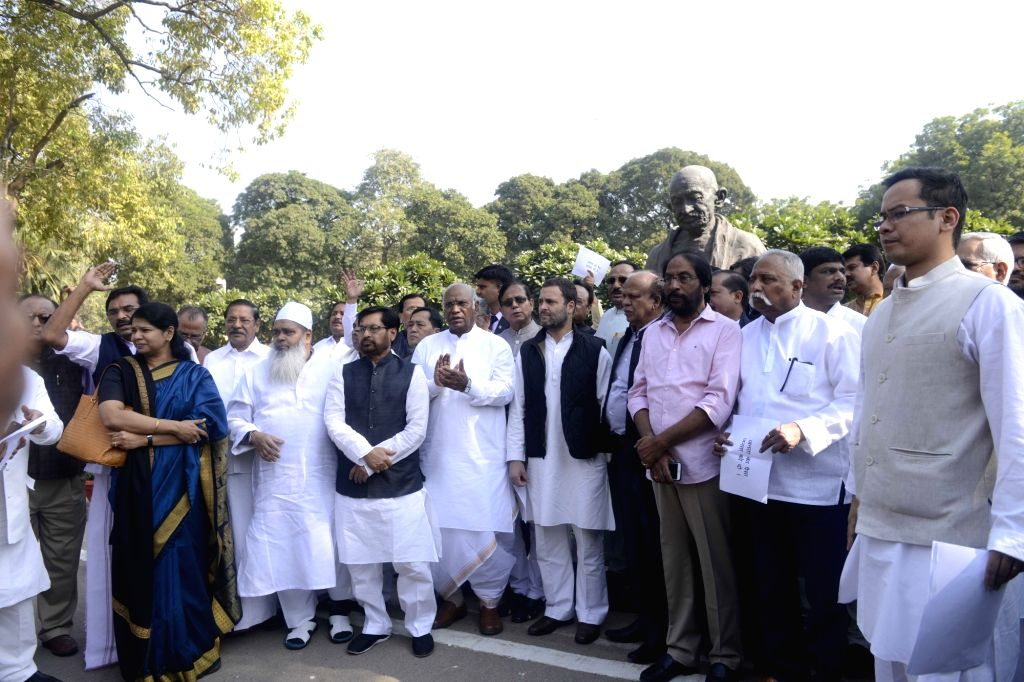 Opposition leaders including Rahul Gandhi and Mallikarjun Kharge of Congress and Sharad Yadav of JD-U stage a demonstration against demonetisation outside Parliament in New Delhi on Nov ... - Rahul Gandhi and Sharad Yadav