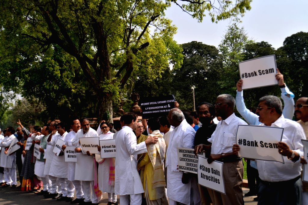 Opposition legislators stage a demonstration at Parliament in New Delhi on April 5, 2018.