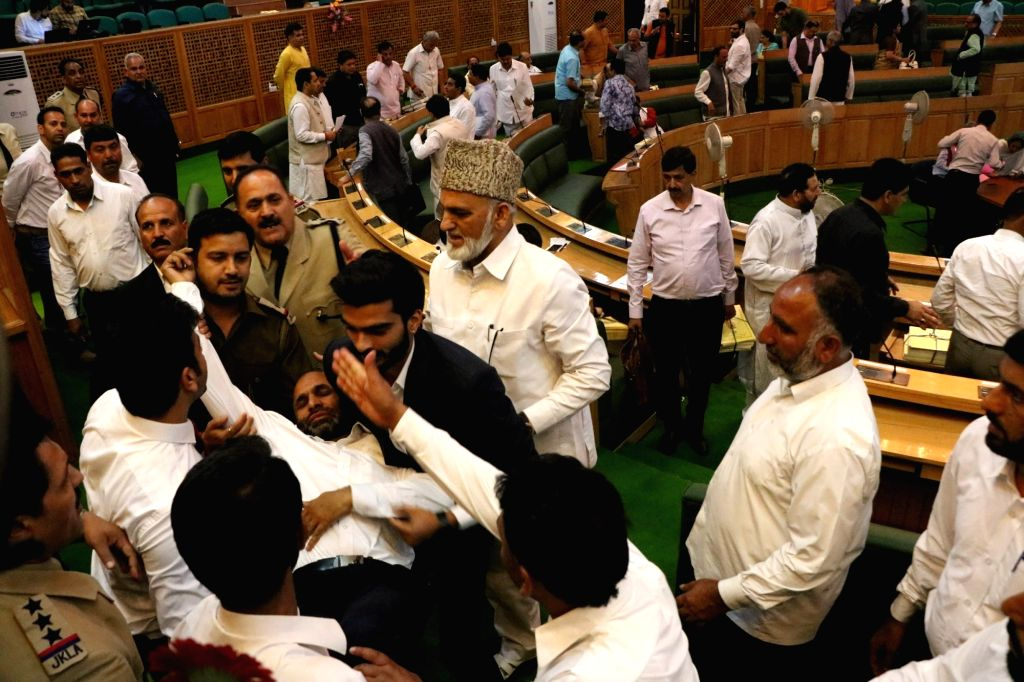 Opposition members create ruckus during a session in the Jammu & Kashmir Legislative Assembly on July 4, 2017.