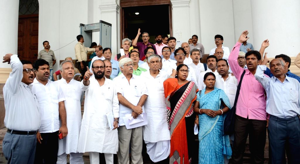 Opposition MLA's walkout from West Bengal Assembly to protest against the state government in Kolkata on Aug 27, 2019.