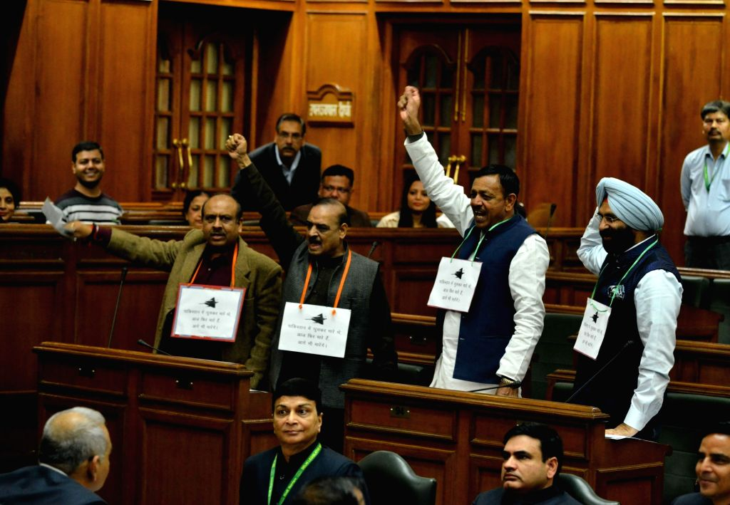 Opposition MLAs during the state budget for 2019-20 at Delhi Legislative Assembly in New Delhi on Feb 26, 2019.