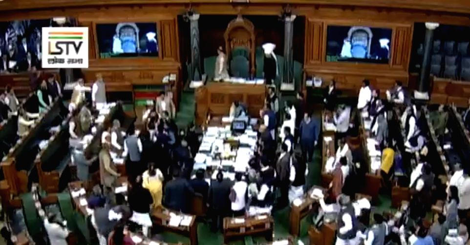 Opposition MLAs enter the well of the House and create a ruckus over treasury benches raising issue over Congress leader Rahul Gandhi's jibe against Prime Minister Narendra Modi, saying ... - Narendra Modi and Rahul Gandhi