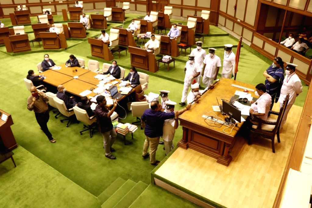 Opposition MLAs reached near chair of Speaker Rajesh Patnekar after the Government refused to answer on the Star Question on Coal Handling in Goa and Mhadei River issue during the 'Question Hour' at ... - Rajesh Patnekar