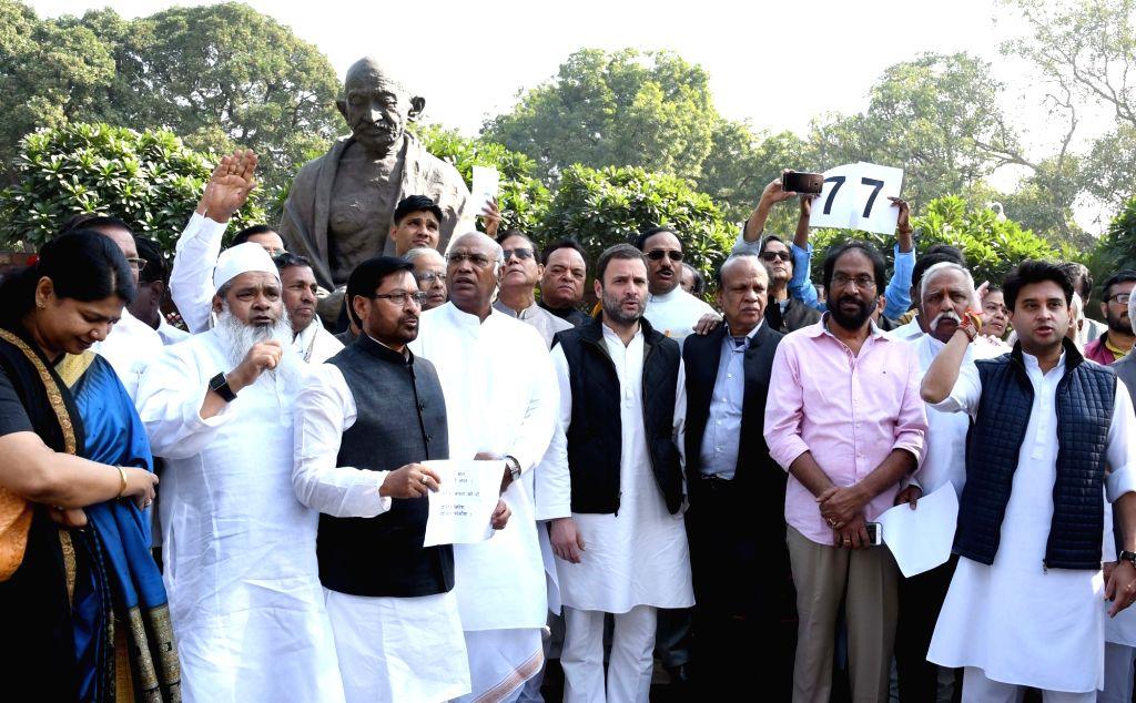 Opposition MPs including Rahul Gandhi, Mallikarjun Kharge stage a demonstration against demonetisation at Parliament in New Delhi on Nov 28, 2016. - Rahul Gandhi
