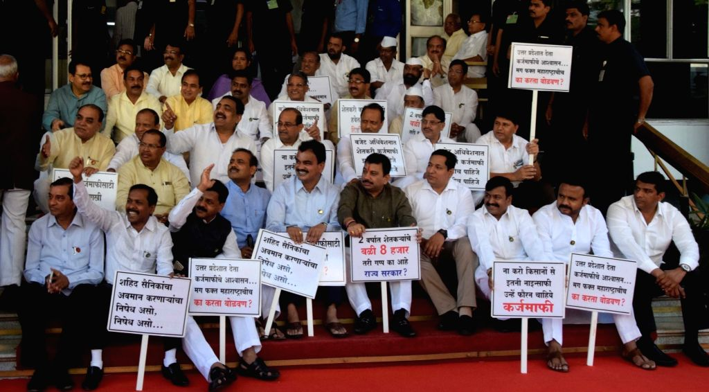 Opposition party leaders in Maharashtra stage a demonstration demanding loan waiver for farmers in the state outside Maharashtra Legislative Assembly in Mumbai on March 9, 2017.