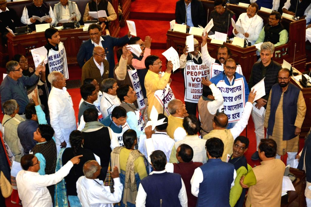 Opposition party legislators stage a demonstration demanding a discussion on West Bengal Governor Keshari Nath Tripathi's inaugural address during the Budget session of the state assembly, ... - Keshari Nath Tripathi