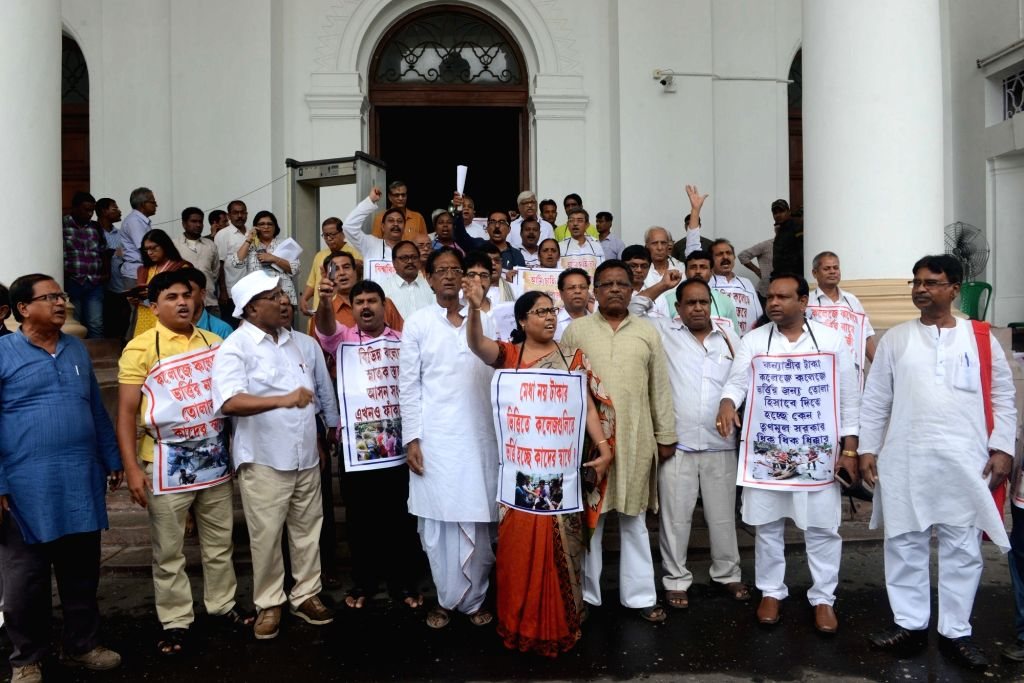 Opposition party legislators stage a protest against the West Bengal Government at the state assembly, in Kolkata on July 23, 2018.