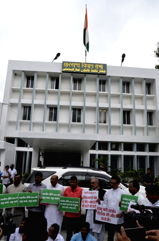 Opposition party legislatures stage a demonstration over the controversial domicile policy during the Monsoon session of the Jharkhand Assembly in Ranchi on July 27, 2016.