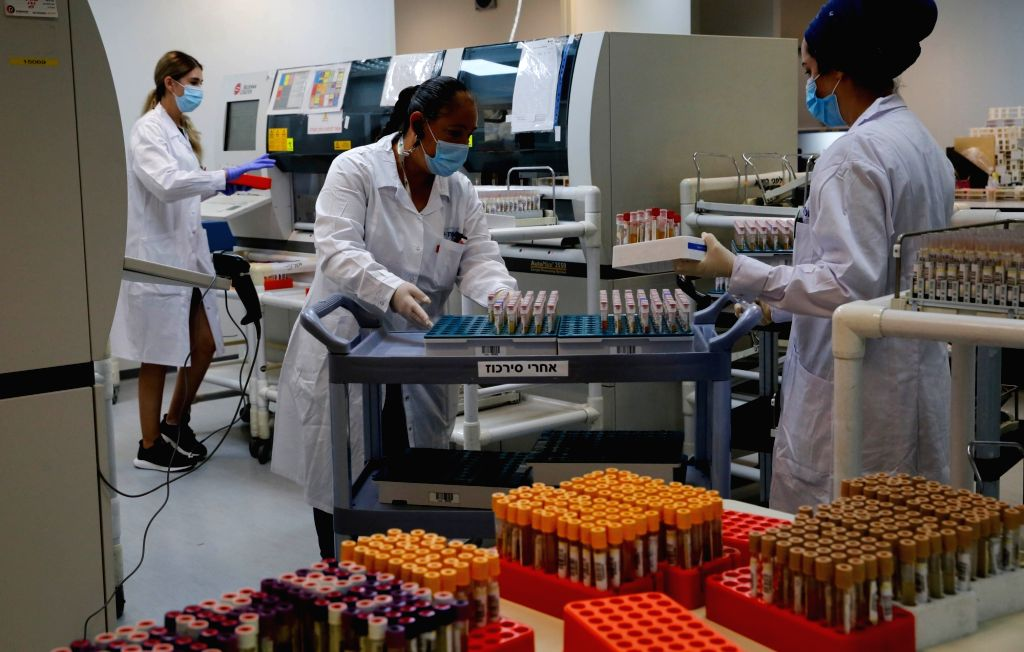 Or Yehuda, Sept. 13, 2020 (Xinhua) -- Medical workers conduct serological tests for coronavirus at a Leumit Health Care Services laboratory in central Israeli city of Or Yehuda, on Sept. 13, 2020. Israel's Ministry of Health reported 2,882 new COVID-