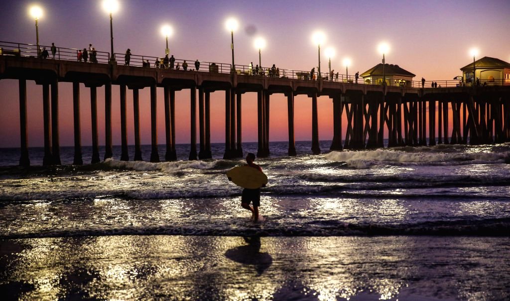 ORANGE COUNTY (U.S.), Nov. 3, 2019 A surfer is seen during sunset on the Huntington Beach, California, the United States, on Nov. 2, 2019.