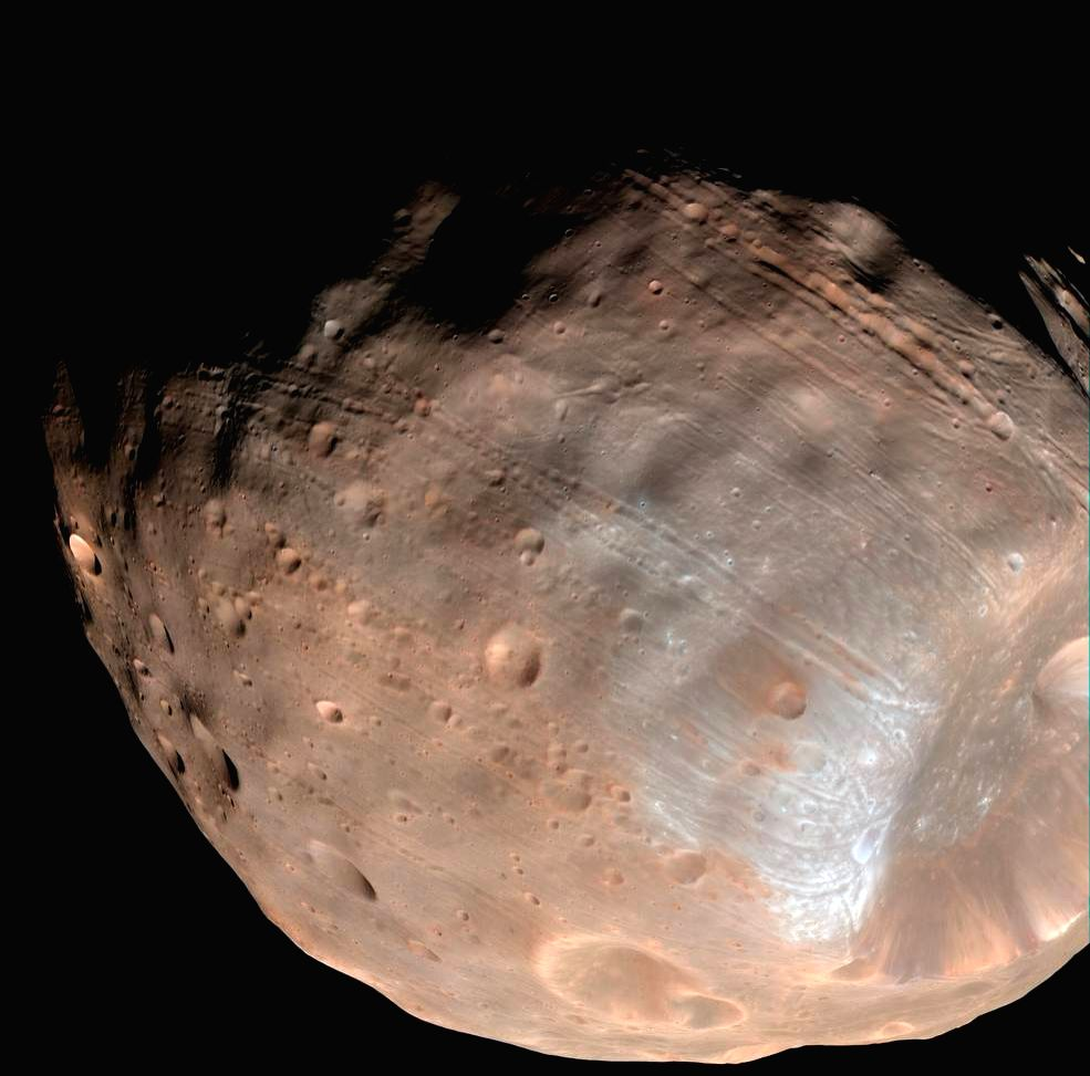 Orbiting a mere 6,000 kms above the surface of Mars, Phobos is closer to its planet than any other moon in the solar system. (Photo: NASA)