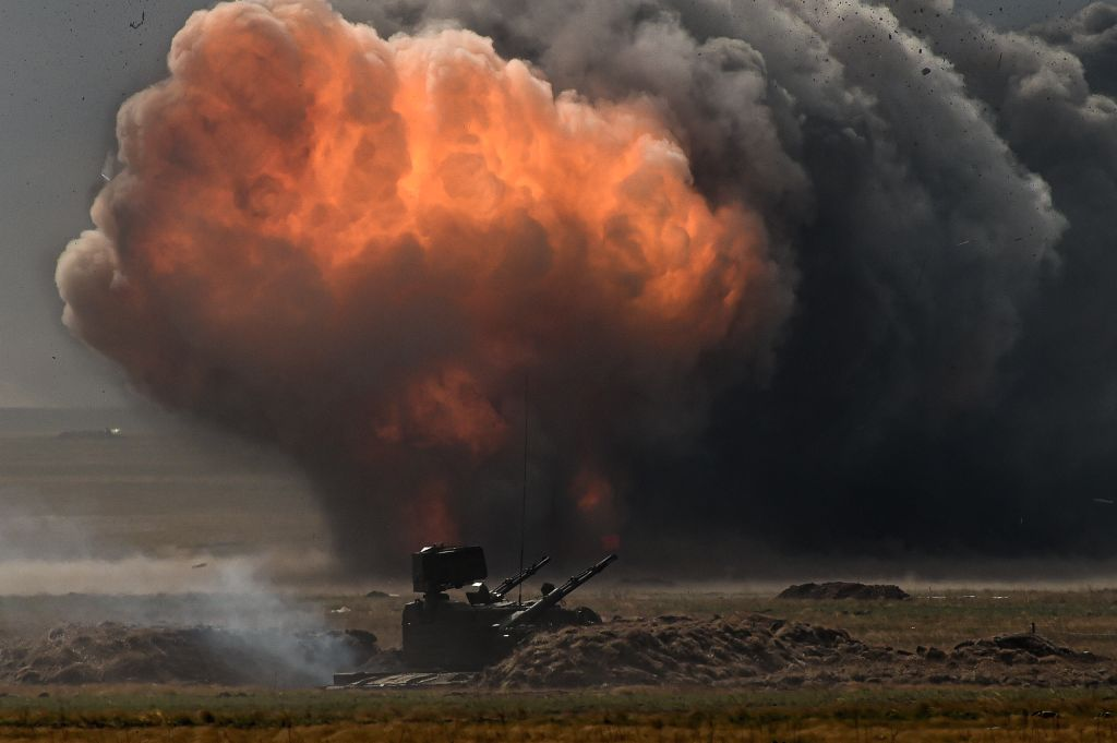 ORENBURG (RUSSIA), Sept. 20, 2019 (Xinhua) -- Explosions on the battlefield are seen during the Center-2019 military exercises in Orenburg region, Russia, on Sept. 20, 2019. Tsentr-2019 (Center-2019) military exercises involving eight countries began