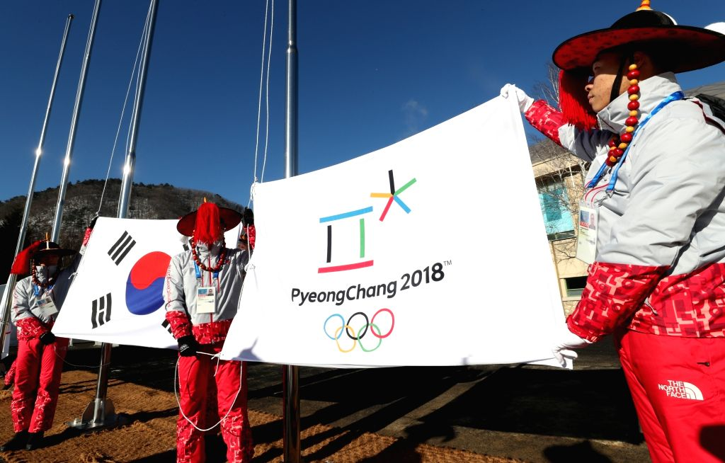 Organizers of the PyeongChang Olympics practice raising the national flag of South Korea and the Olympic flag at the athletes' village in PyeongChang, Gangwon Province, on Feb. 1, 2018