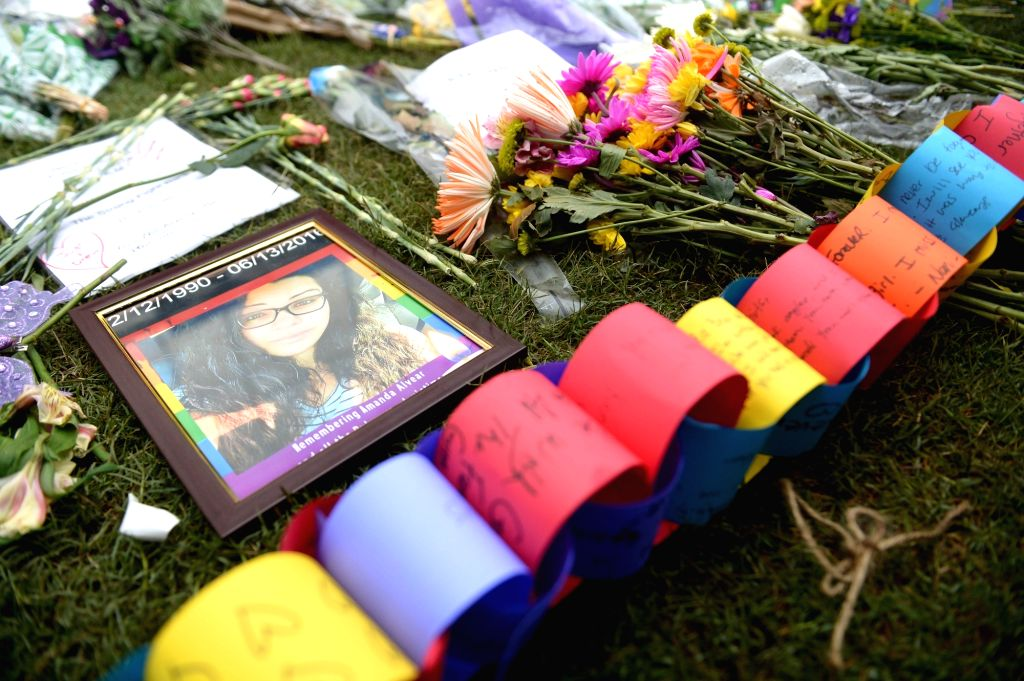 ORLANDO, June 14, 2016 (Xinhua) -- Photo taken on June 13, 2016 shows a portrait of a victim of the Pulse nightclub shooting in Orlando, the United States. At least 50 people were killed and 53 others wounded early Sunday in the shooting at the popul