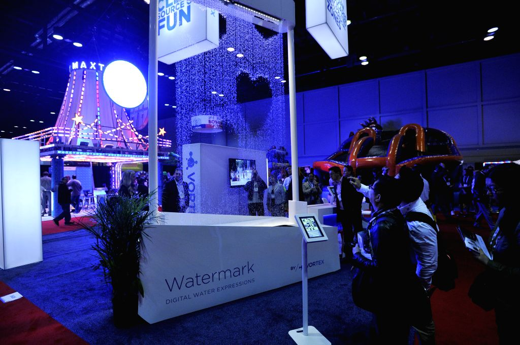 Orlando (U.S.) : People visit exhibition booth of water mark at the International Association of Amusement Parks and Attractions (IAAPA) Attractions Expo 2014 in Orlando, Florida, the United States, .