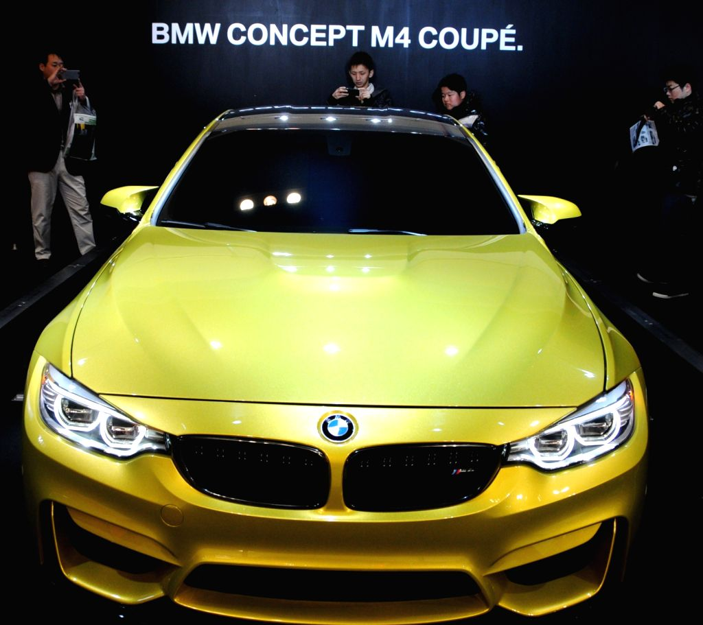 A BMW concept car is displayed at the 8th Osaka Auto Exhibition in Osaka, Japan, Dec. 20, 2013. Some 305 vehicles from 288 manufacturers attended the four-day ...