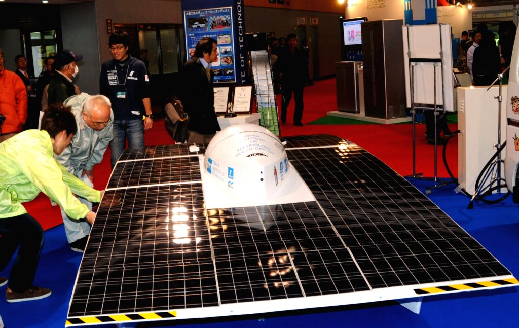A solar car is displayed at the 8th Osaka Auto Exhibition in Osaka, Japan, Dec. 20, 2013. Some 305 vehicles from 288 manufacturers attended the four-day ...