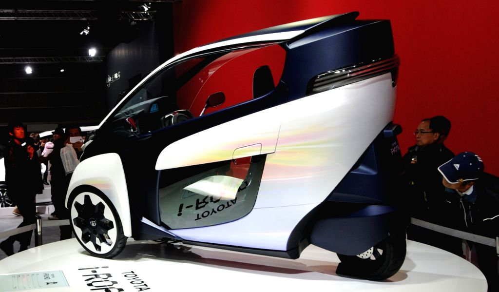 A Toyota vehicle is displayed at the 8th Osaka Auto Exhibition in Osaka, Japan, Dec. 20, 2013. Some 305 vehicles from 288 manufacturers attended the four-day ...