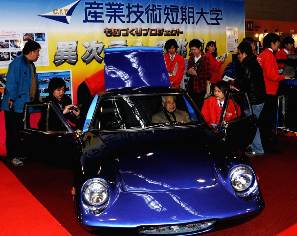 An electric car is displayed at the 8th Osaka Auto Exhibition in Osaka, Japan, Dec. 20, 2013. Some 305 vehicles from 288 manufacturers attended the four-day ...
