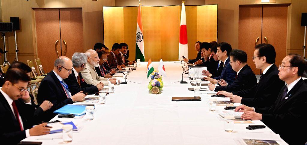 Osaka: Prime Minister Narendra Modi and Japan Prime Minister Shinzo Abe during a bilateral meeting in Osaka, Japan on June 27, 2019. (Photo: IANS/PIB) - Narendra Modi