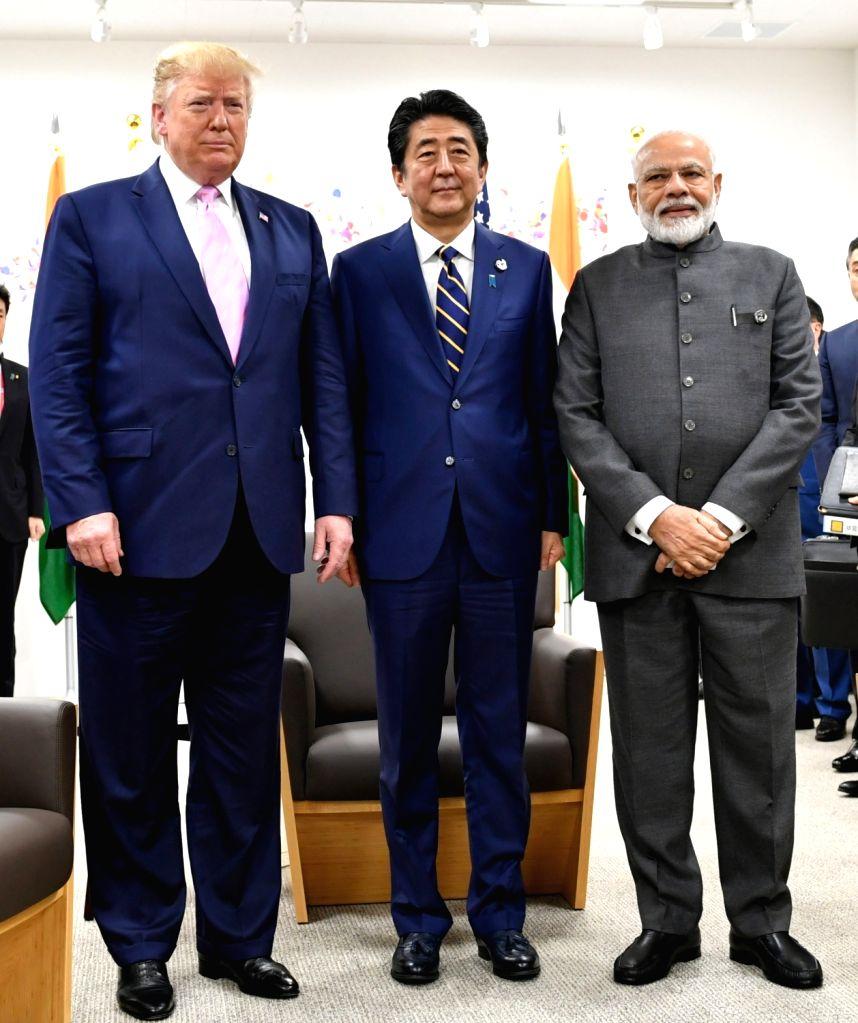Osaka: Prime Minister Narendra Modi with Japanese Prime Minister Shinzo Abe and US President Donald Trump in a Trilateral Meeting of JAI (Japan-America-India), in Osaka, Japan  on June 28, 2019. (Photo: IANS/PIB) - Narendra Modi