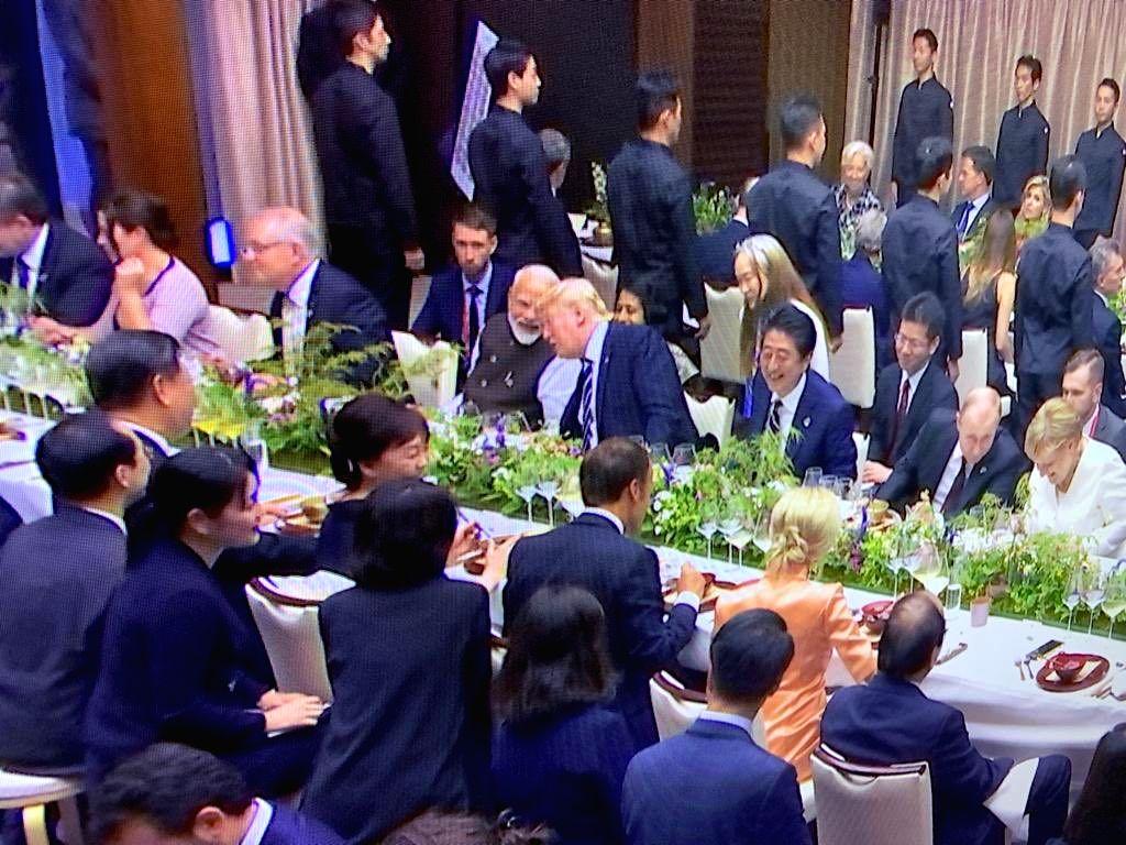 Osaka: Prime Minister Narendra Modi with US President Donald Trump, Japanese Prime Minister Shinzo Abe, Russian President Vladimir Putin, German Chancellor Angela Merkel and other leaders of the G20 Member countries at the dinner in Osaka, Japan on J - Narendra Modi