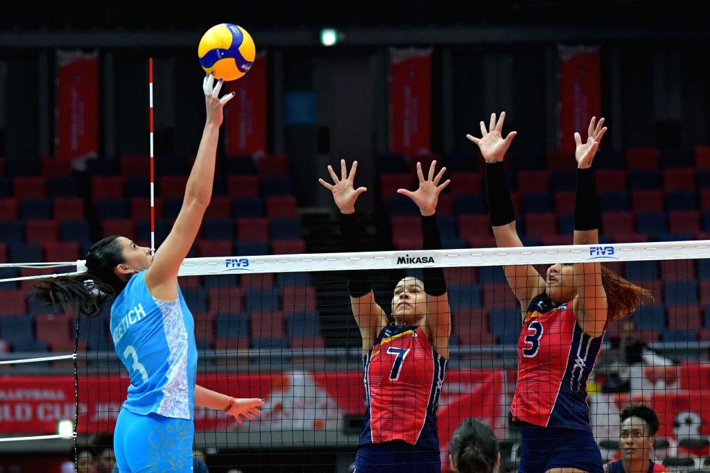 OSAKA, Sept. 27, 2019 - Paula Yamila Nizetich (L) of Argentina spikes during the Round Robin match between the Dominican Republic and Argentina at the 2019 FIVB Women's World Cup in Osaka, Japan, ...