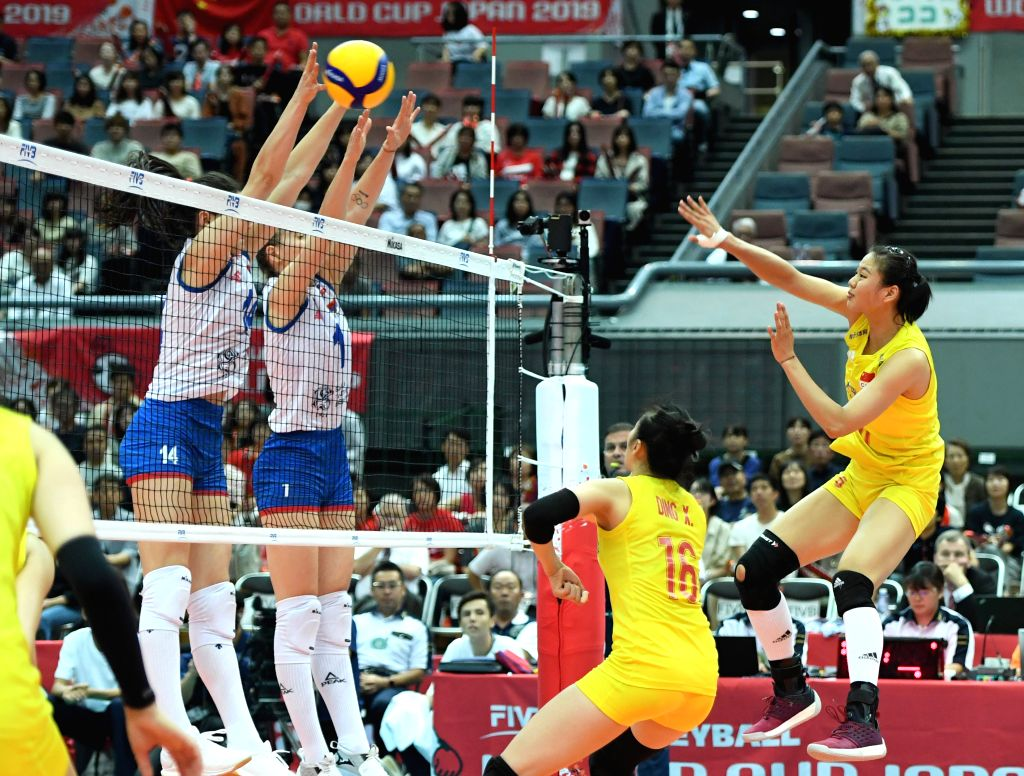 OSAKA, Sept. 28, 2019 - Gong Xiangyu (Top R) spikes the ball during the Round Robin match between China and Serbia at the 2019 FIVB Women's World Cup in Osaka, Japan, Sept. 28, 2019.
