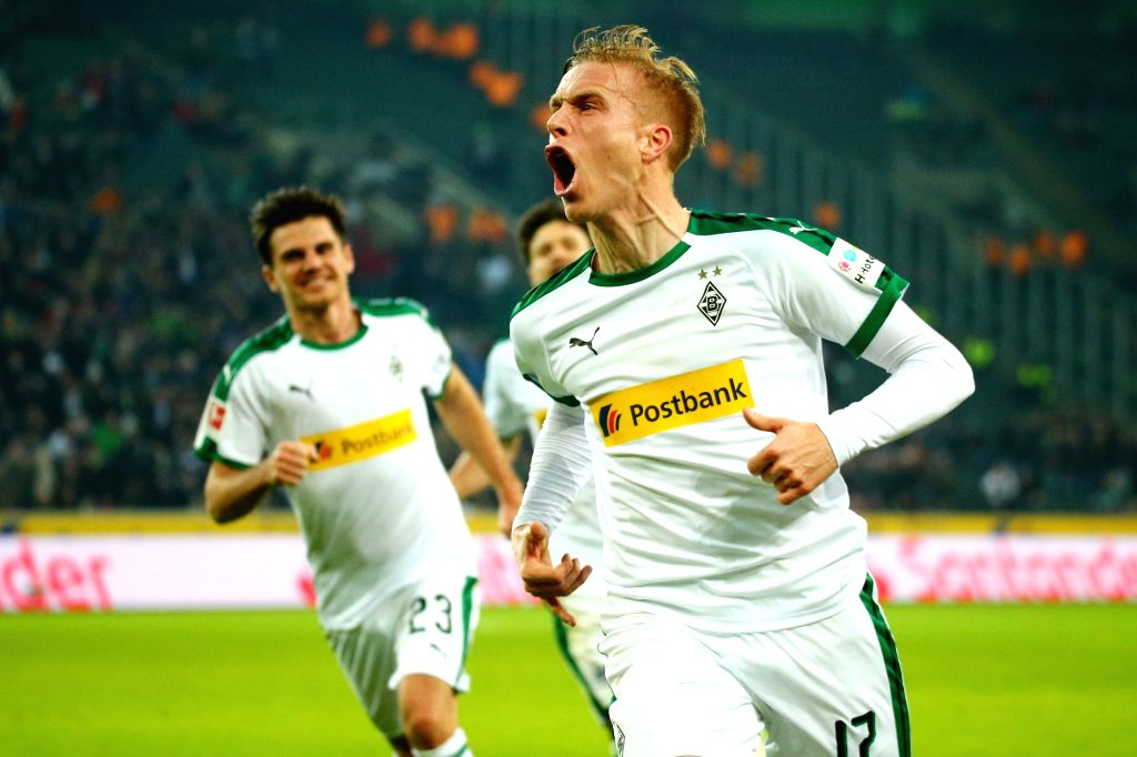 Oscar Wendt (front) of Moenchengladbach celebrates scoring during the Bundesliga match between Borussia Moenchengladbach and FC Augsburg in ...