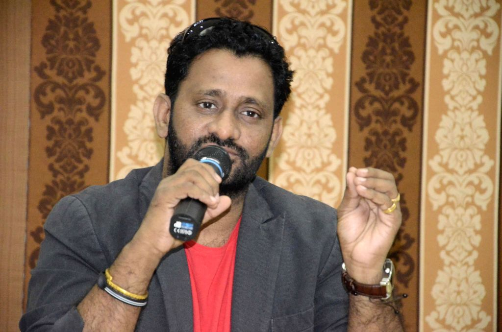 Oscar winning sound designer Resul Pookutty during music release of `A Rainy Day` - a Marathi film in Mumbai on Dec.19, 2013. (Photo: IANS)