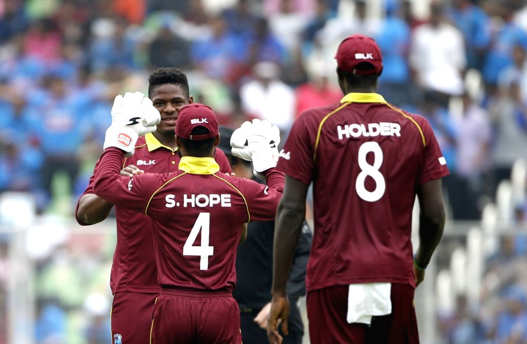 Oshane Thomas of West Indies celebrates fall of Shikhar Dhawan's wicket during the fifth and final ODI match between India and West Indies in Thiruvananthapuram, on Nov. 1, 2018.