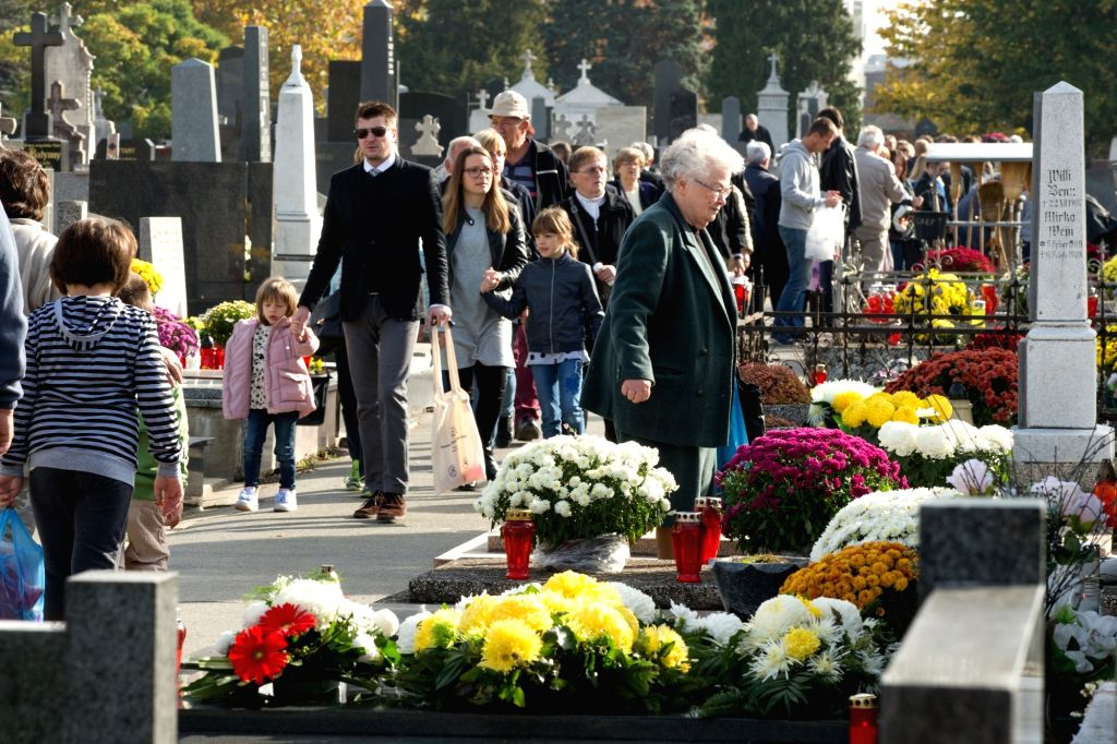 OSIJEK (CROATIA), Nov. 1, 2018 People pay their respects to the deceased at a cemetery in Osijek, Croatia, on Nov. 1, 2018. Croatian people gathered at cemeteries around the country to ...