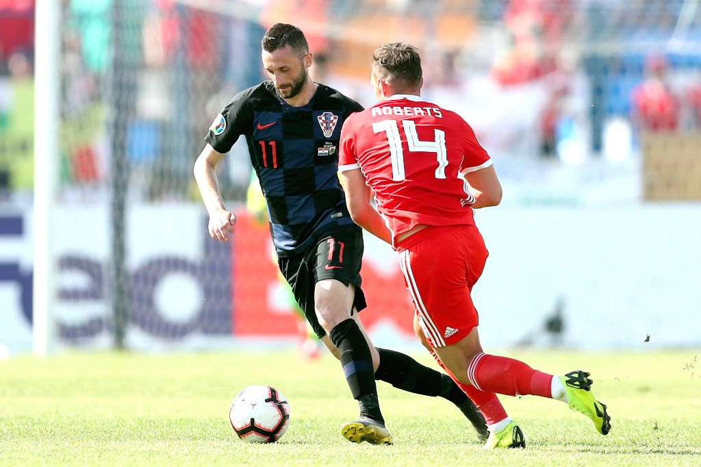 OSIJEK, June 9, 2019 - Marcelo Brozovic (L) of Croatia vies with Connor Roberts of Wales during the UEFA Euro 2020 Group E qualifier in Osijek, Croatia, June 8, 2019. Croatia won 2-1.