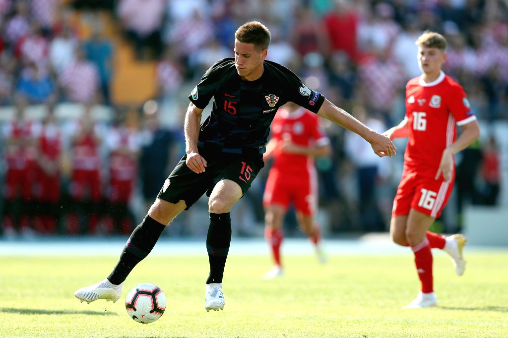 OSIJEK, June 9, 2019 - Mario Pasalic (front) of Croatia competes during the UEFA Euro 2020 Group E qualifier between Croatia and  Wales in Osijek, Croatia, June 8, 2019. Croatia won 2-1.