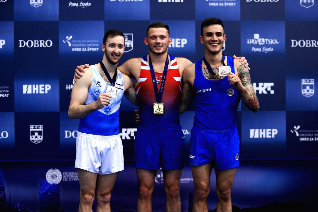 OSIJEK, May 27, 2018 - Gold medalist Dominick Cunningham (C) of Britain, silver medalist Artem Dolgopyat (L) of Israel and bronze medalist Nicola Bartolini of Italy pose during the awarding ceremony ...