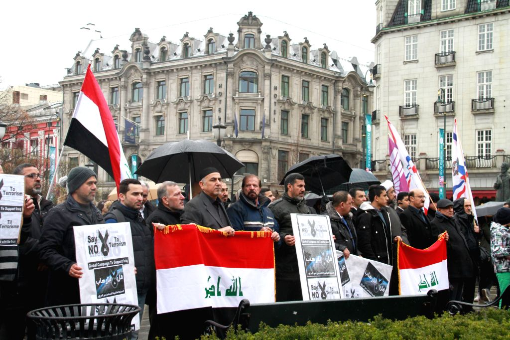"""Overseas Iraqis attend a protest against the terrorism activities of the extremist group """"Islamic State"""" (IS) in Oslo, Norway, March 20, 2015. (Xinhua/Liang ..."""