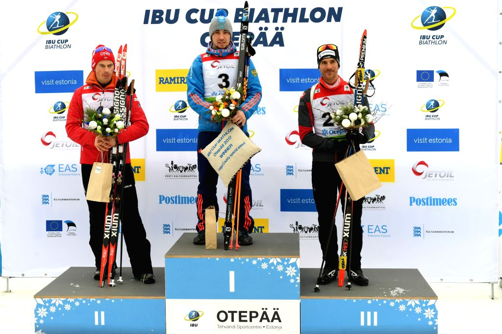 OTEPAA, March 11, 2017 - Alexandr Loginov(C) of Russia poses with Norwegian Henrik L' Abee-Lund(L) and Martin Jaeger of Switzerland during the awarding ceremony of Men's 10km sprint race of IBU Cup ...