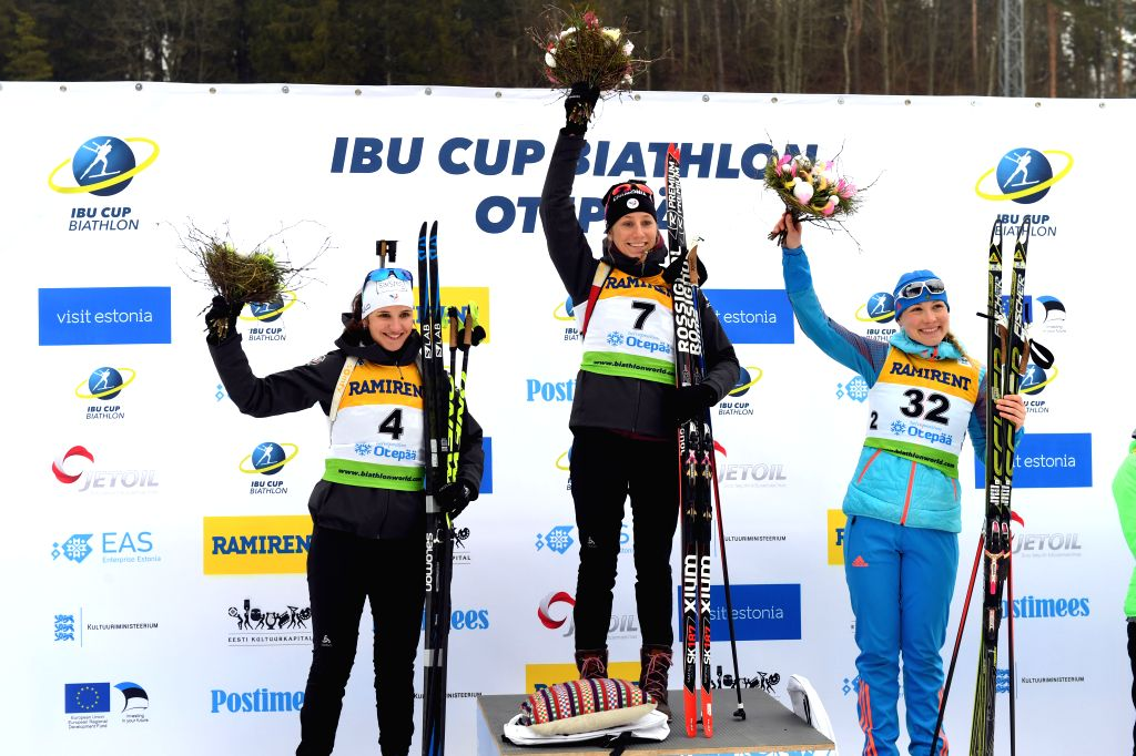 OTEPAA, March 11, 2017 - First place winner Enora Latuilliere (C) of France pose with her teammate, second place winner Julia Simon (L) and third place winner Anna Nikulina of Russia during the ...