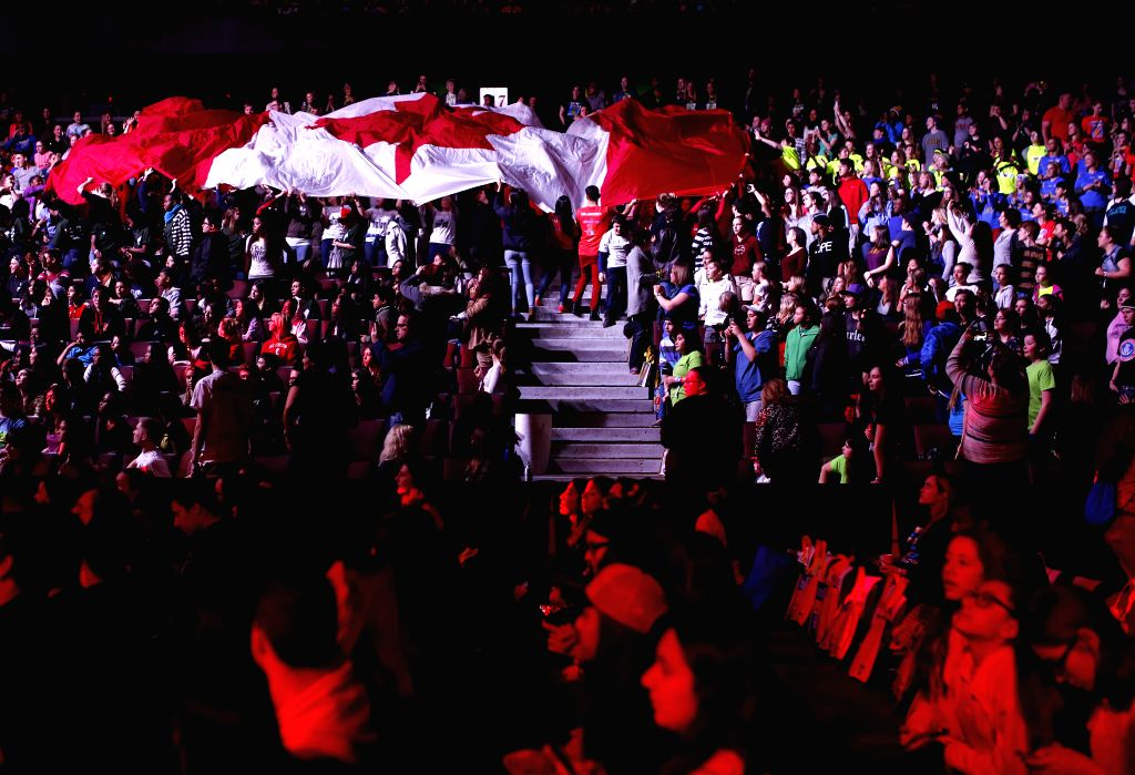 Children pass a Canadian flag as Governor General of Canada David Johnston speaks during the National We Day event in Ottawa, Canada on April 1, 2015. We Day is a ...